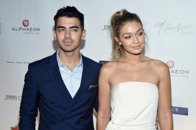 Joe Jonas and Gigi Hadid pose together on a red carpet.