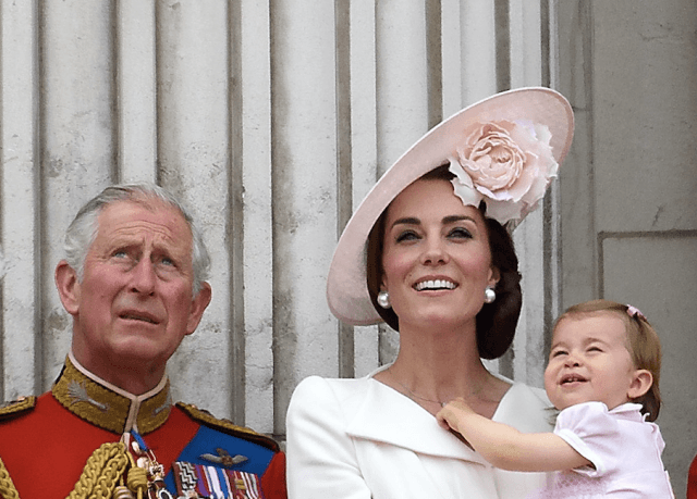 Prince Charles, Kate Middleton wearing a hat, and Princess Charlotte