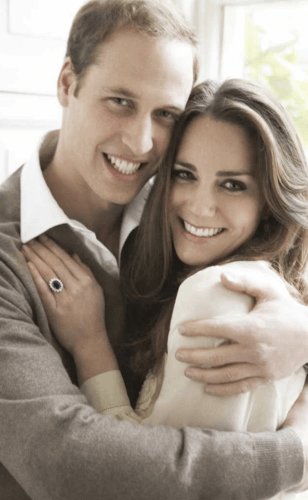 Kate Middleton and Prince William smiling during a photoshoot.