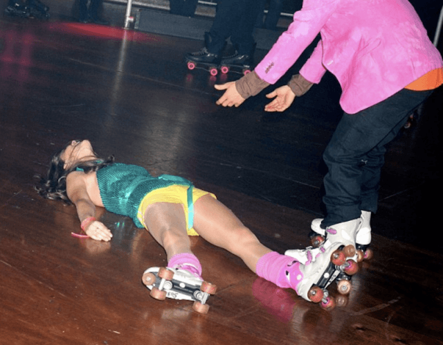 Kate Middleton lies after a roller skate fall.