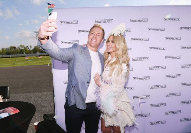 Kroy Biermann and Kim Zolciak taking a selfie together and smiling.