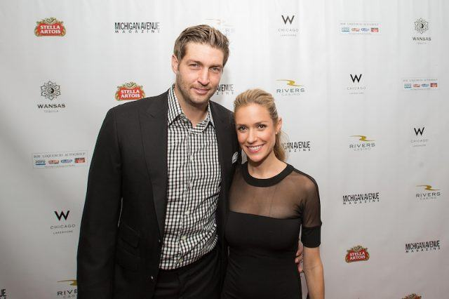 Jay Cutler and Kristin Cavallari posing together on a red carpet.