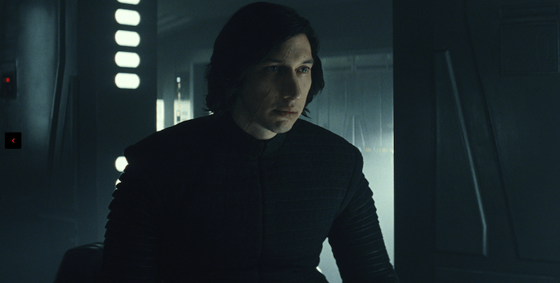 Kylo Ren sits in black clothes