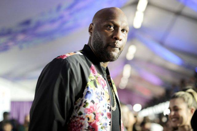 Lamar Odom in a black and floral jacket.