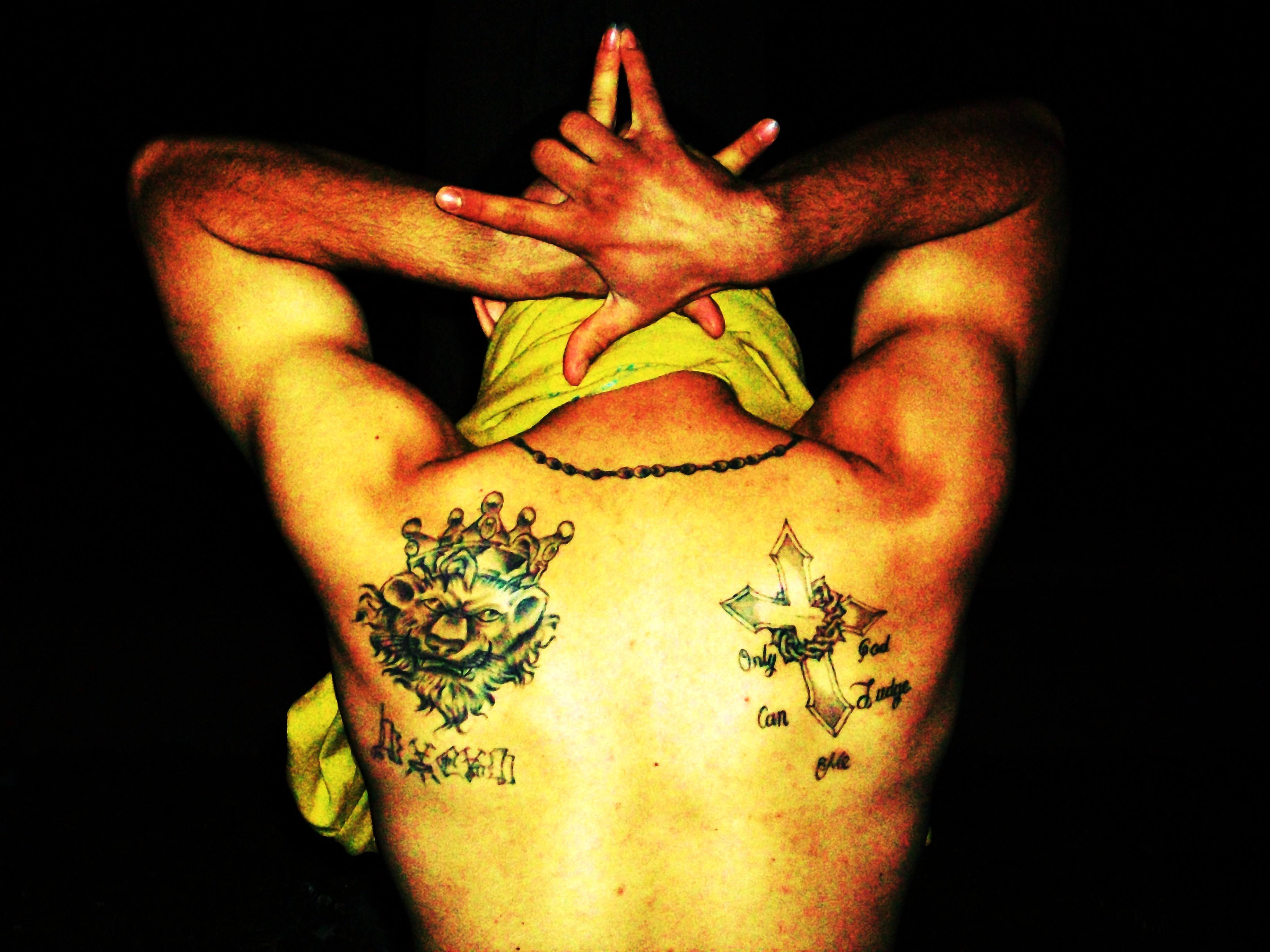 Tattoos and gang sign of Latin Kings gang