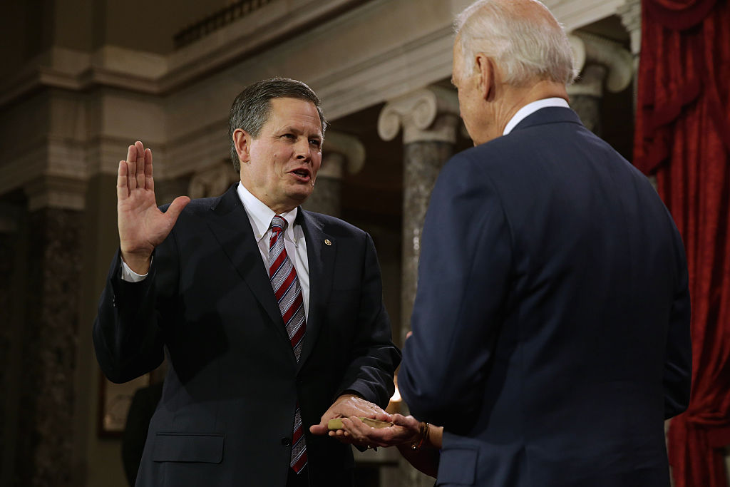 Sen. Steve Daines (R-MT) (L) is ceremonially sworn in by Vice President Joe Biden in the Old Senate Chamber