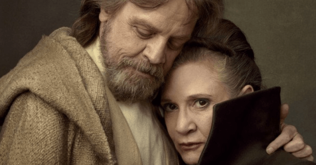 Luke and Leia stand closely together while hugging.