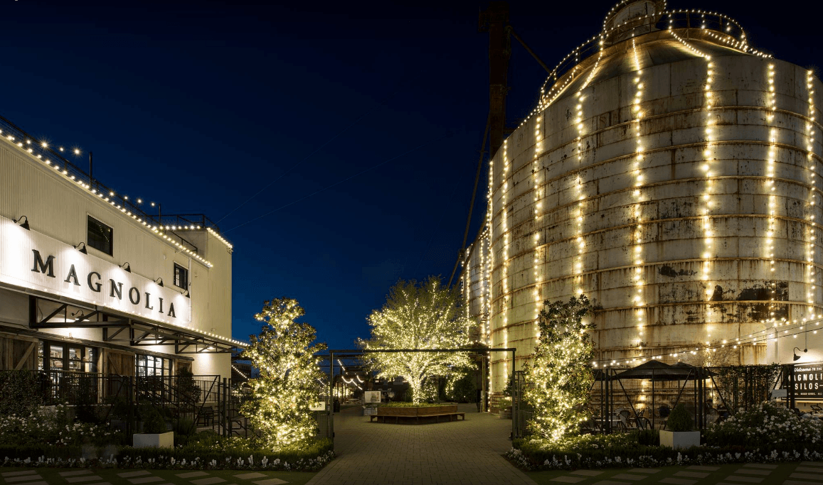 exterior shot of Magnolia Market lit up at night