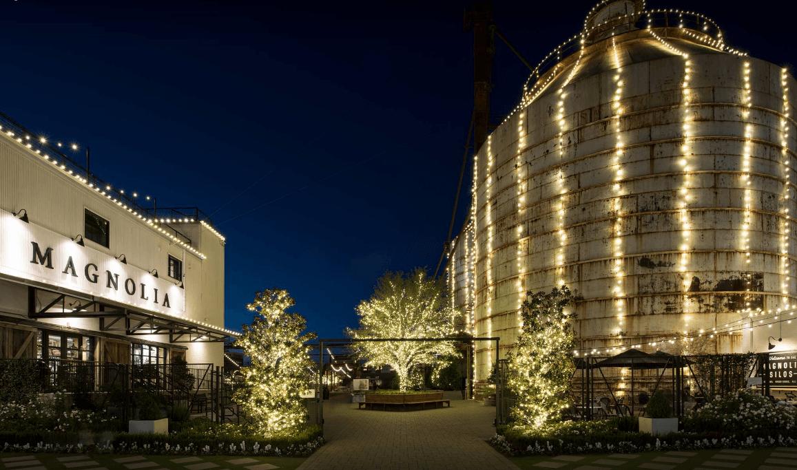 exterior shot of Magnolia Market lit up at night