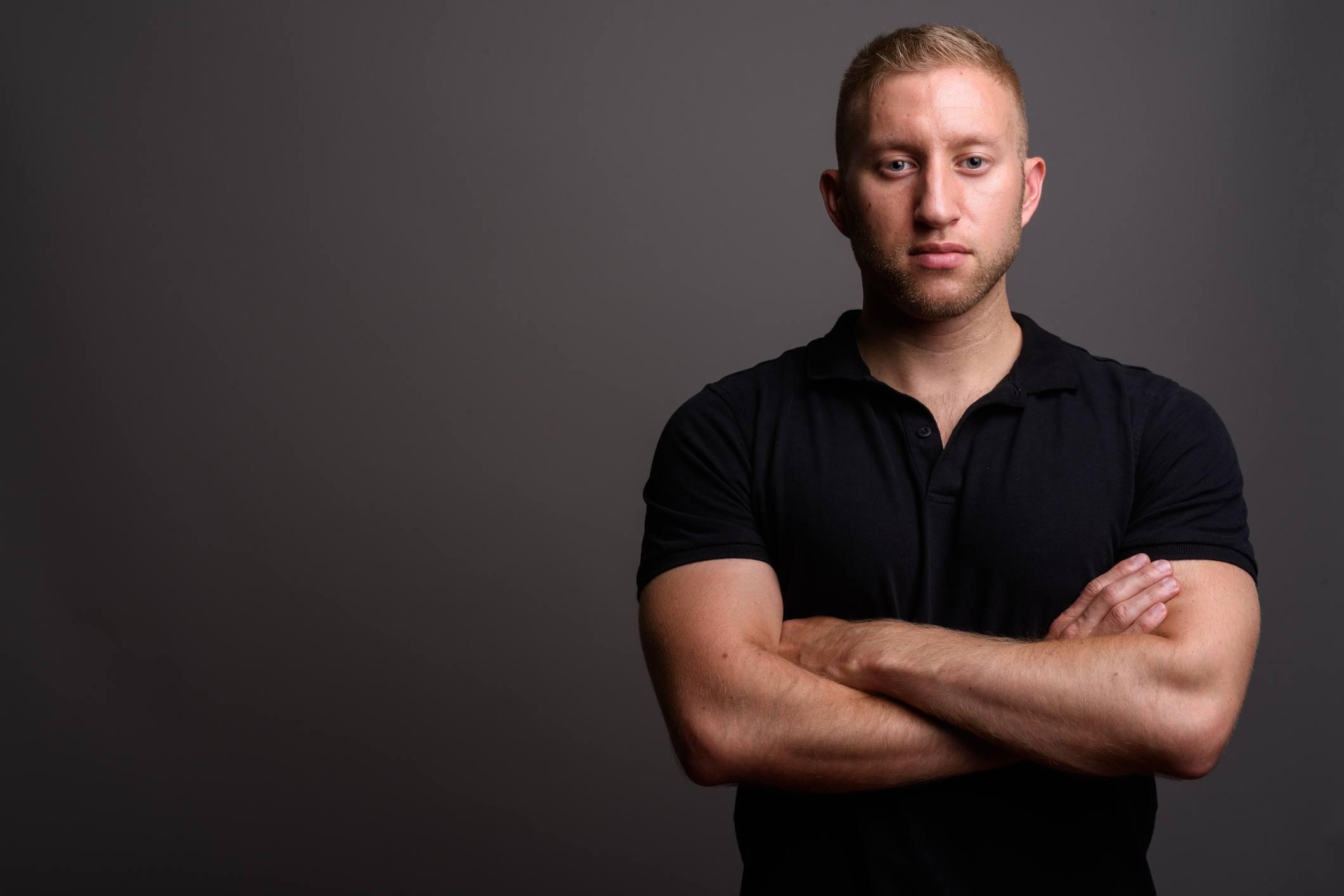 Man with black polo shirt