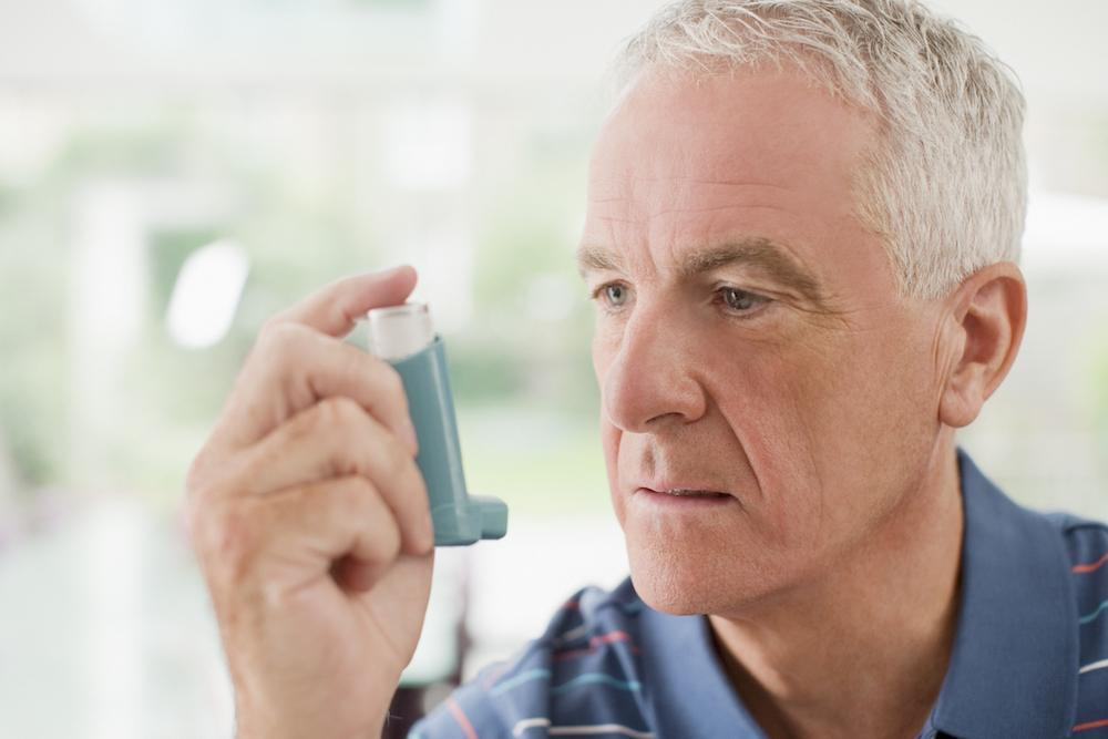 Man about to use an inhaler