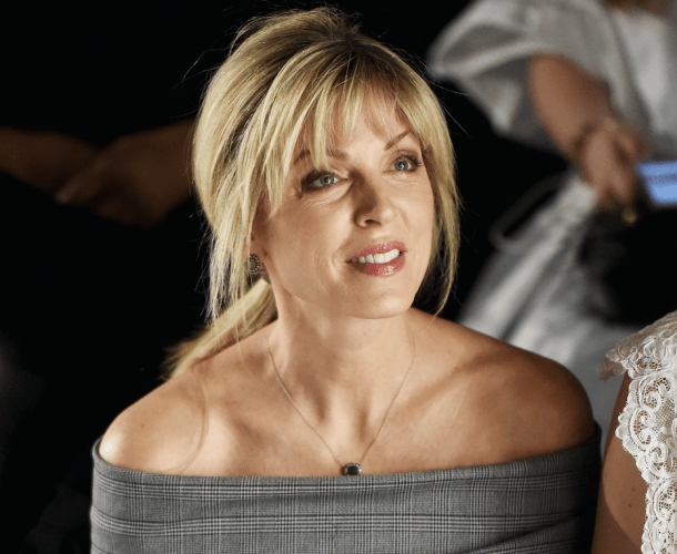 Marla Maples watches a fashion show.