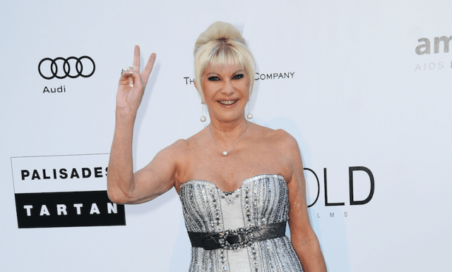 Ivana Trump gives the 'peace' sign on a red carpet.