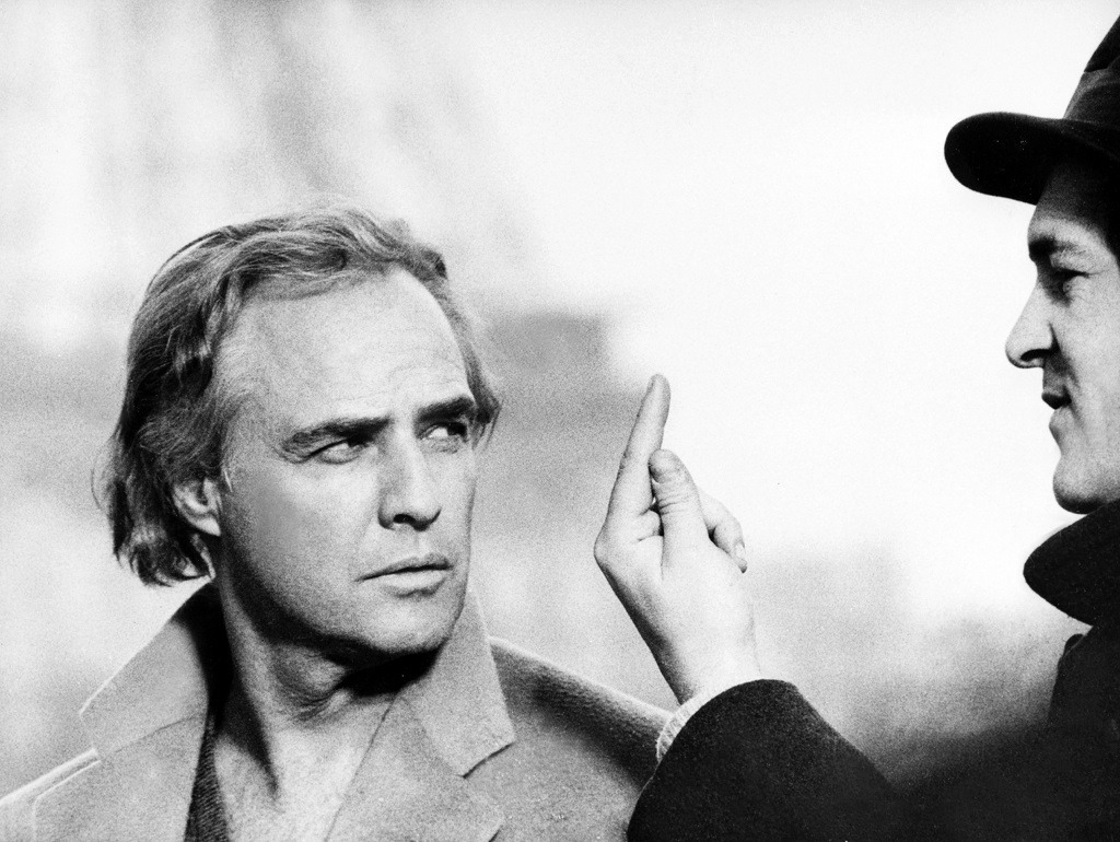 Marlon Brando receives direction during filming.