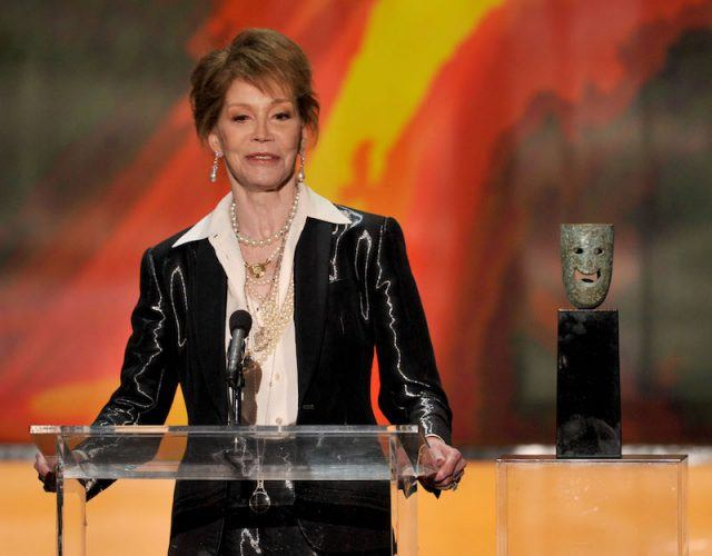 Mary Tyler Moore speaking in front of a podium.