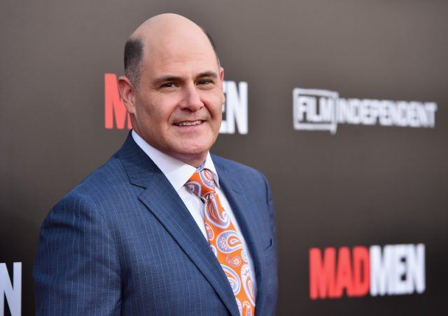 Mathew Weiner posing on a red carpet.