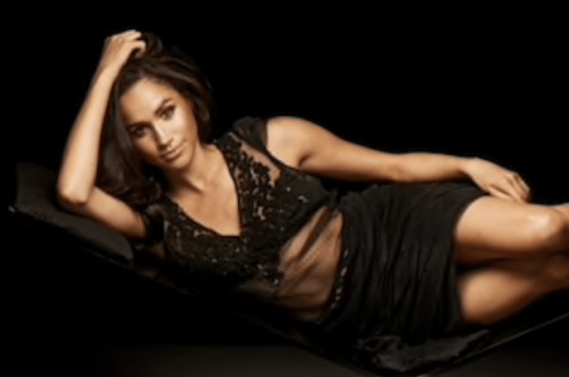 Meghan Markle poses in a black sheer dress.
