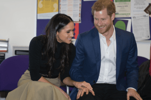 The Meaning Behind Meghan Markle's Adorable Gesture With Prince Harry