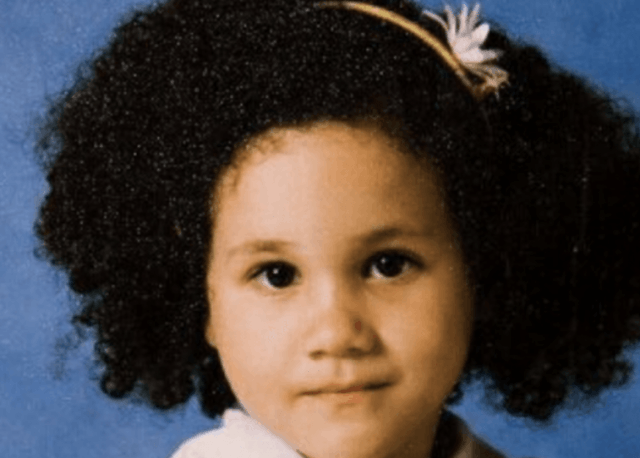 A young Meghan Markle with a headband.