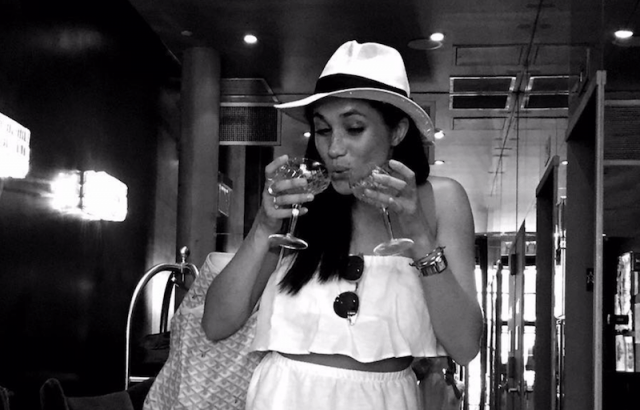 Meghan Markle drinking two glasses of wine