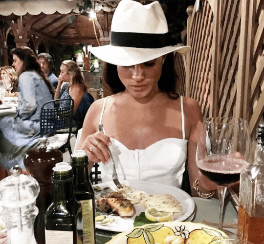 Meghan Markle eating at a restaurant.