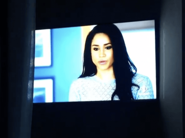 Meghan Markle on a television screen.
