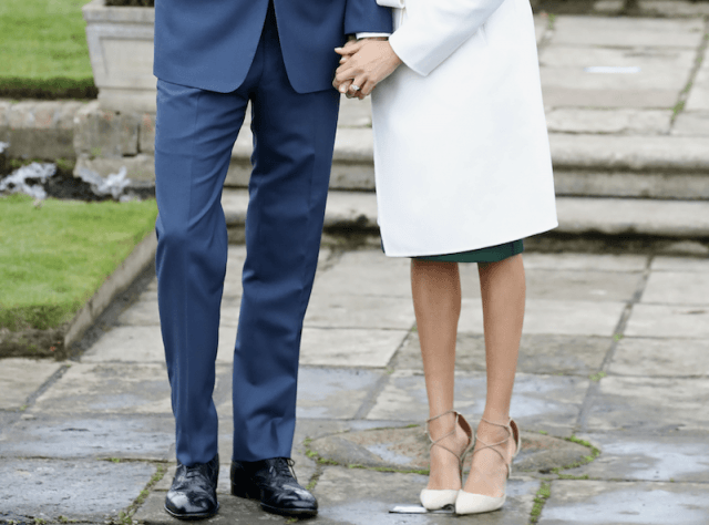 Prince Harry and Meghan Markle's legs and shoes.