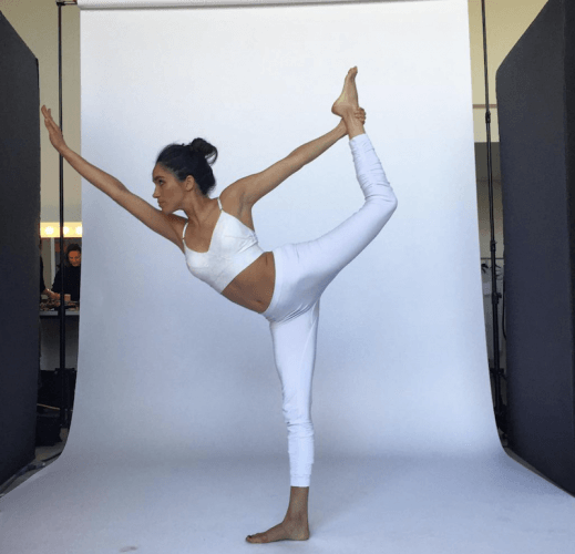Meghan Markle performing yoga.
