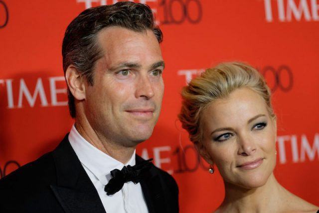 Megyn Kelly and Douglas Brunt posing on a red carpet.
