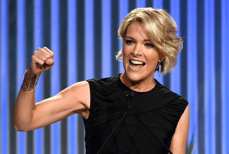 Megyn Kelly smiling and pumping her fist.