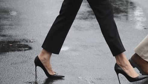 Melania Trump walking in high heels.