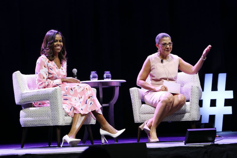 Former First Lady Michelle Obama speaks, emphasizing that women must celebrate their strength, during a live conversation with The Women's Foundation of Colorado President and CEO Lauren Y. Casteel at Pepsi Center on July 25, 2017 in Denver, Colorado.