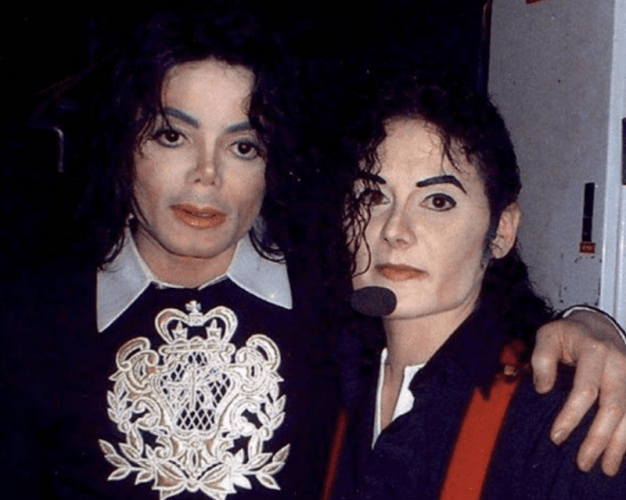 Mikki Jay stands with Michael Jackson.