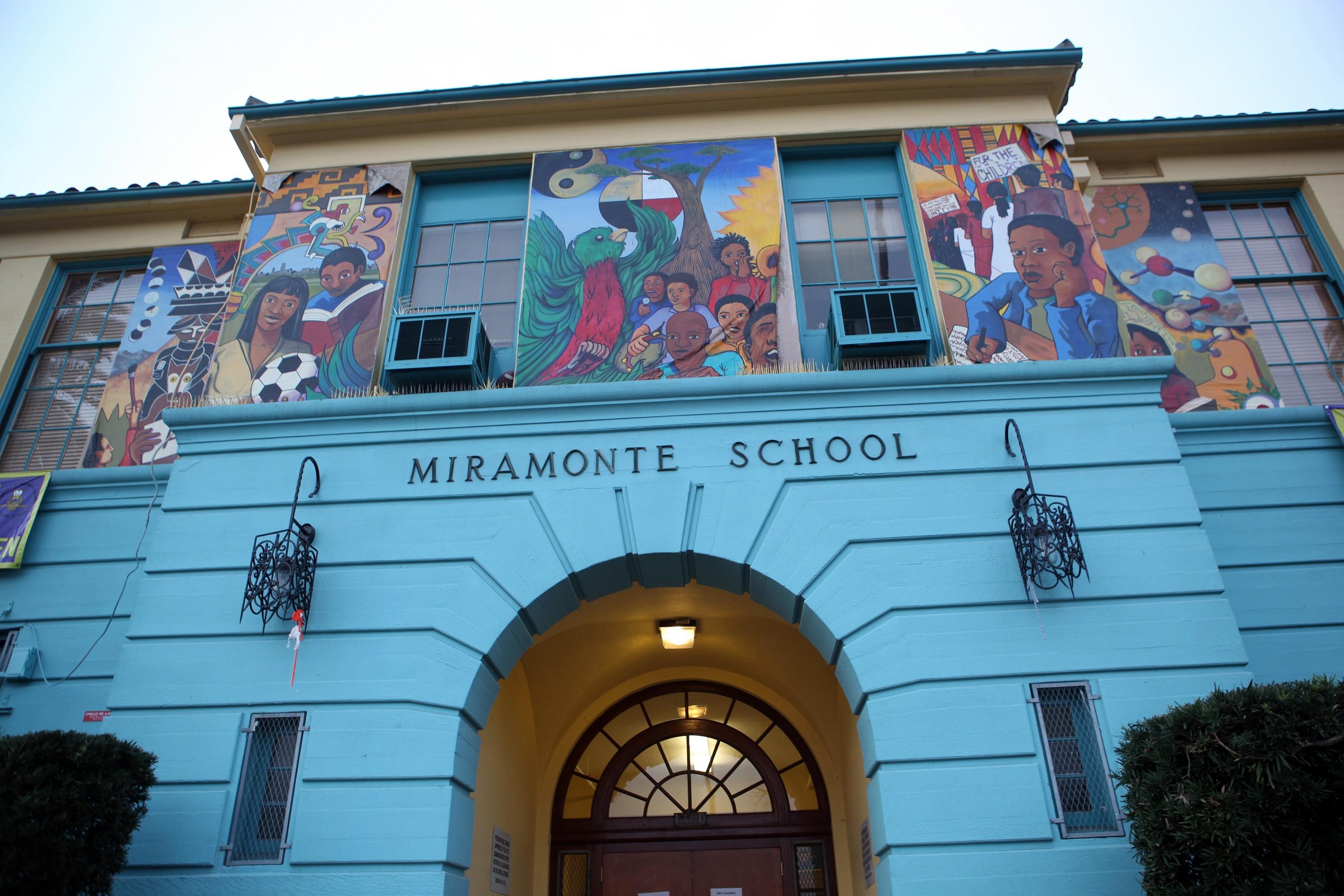 Blue Miramonte Elementary school with murals
