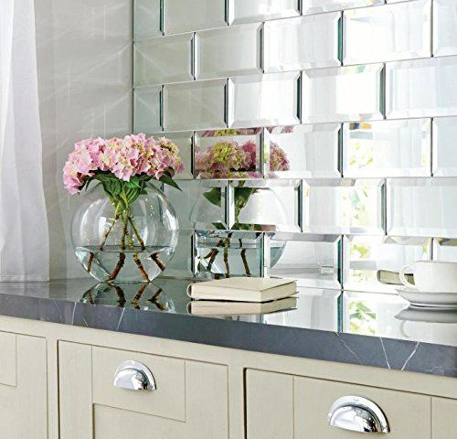 Mirrored backsplash with flowers in vase
