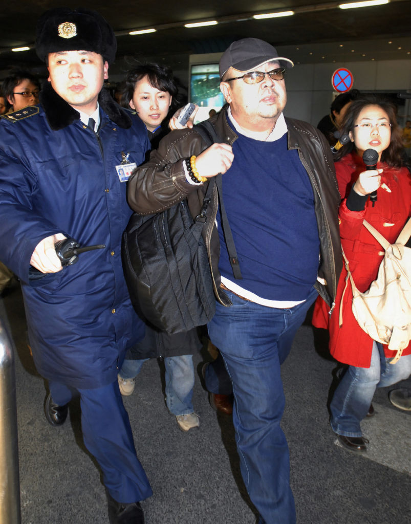 This photo taken on February 11, 2007 shows a man believed to be then-North Korean leader Kim Jong-Il's eldest son, Kim Jong-Nam (C), walking amongst journalists upon his arrival at Beijing's international airport.