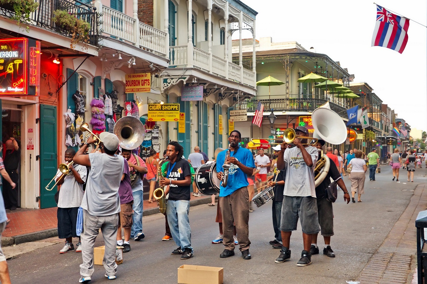 In New Orleans on Bourbon St. on August 7, 2013 a jazz band plays jazz melodies in the street for donations from the tourists and locals passing by on this hot summer evening