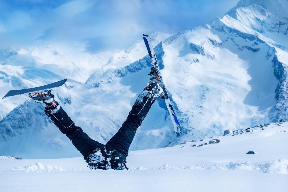 Newbie skier stuck in deep snow