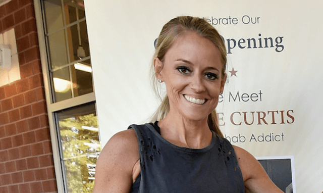 Nicole Curtis smiles while at an event.