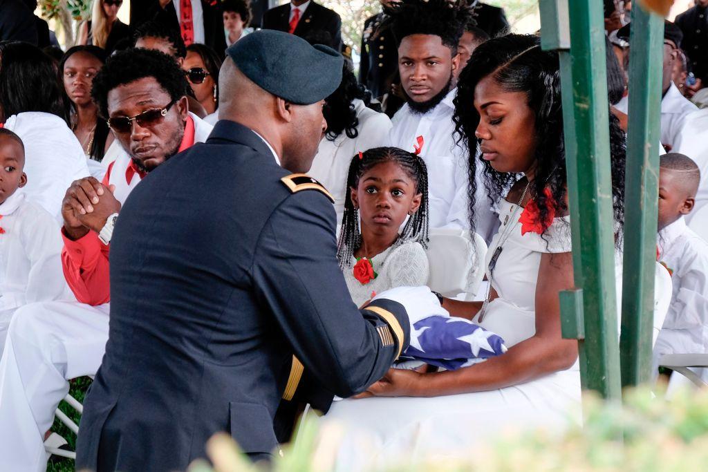 Widow of Niger ambush victim holds American flag