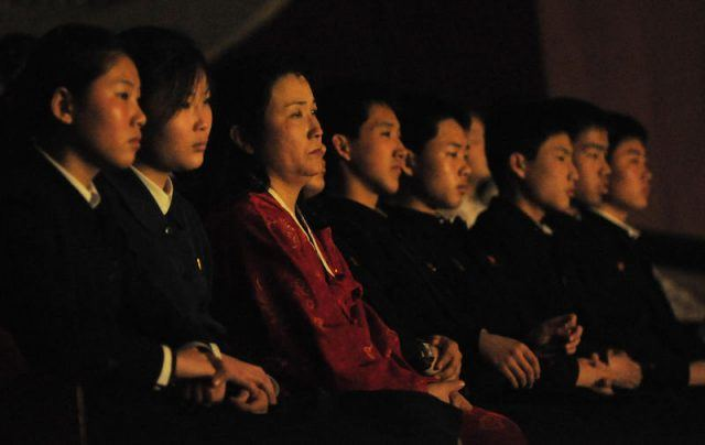 An audience watches a musical performance.