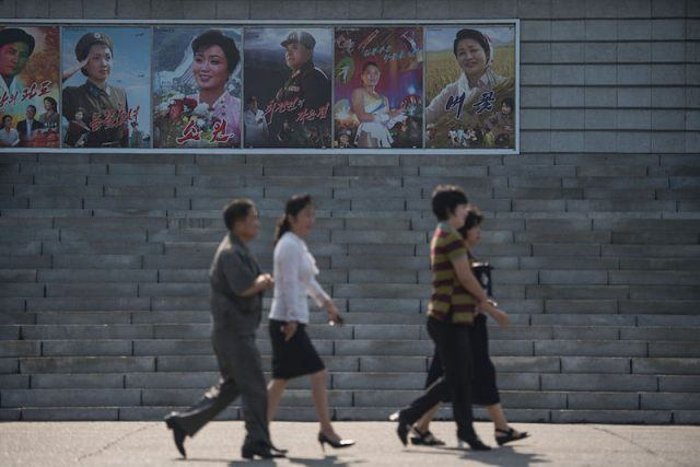 Women and men walking in North Korea.