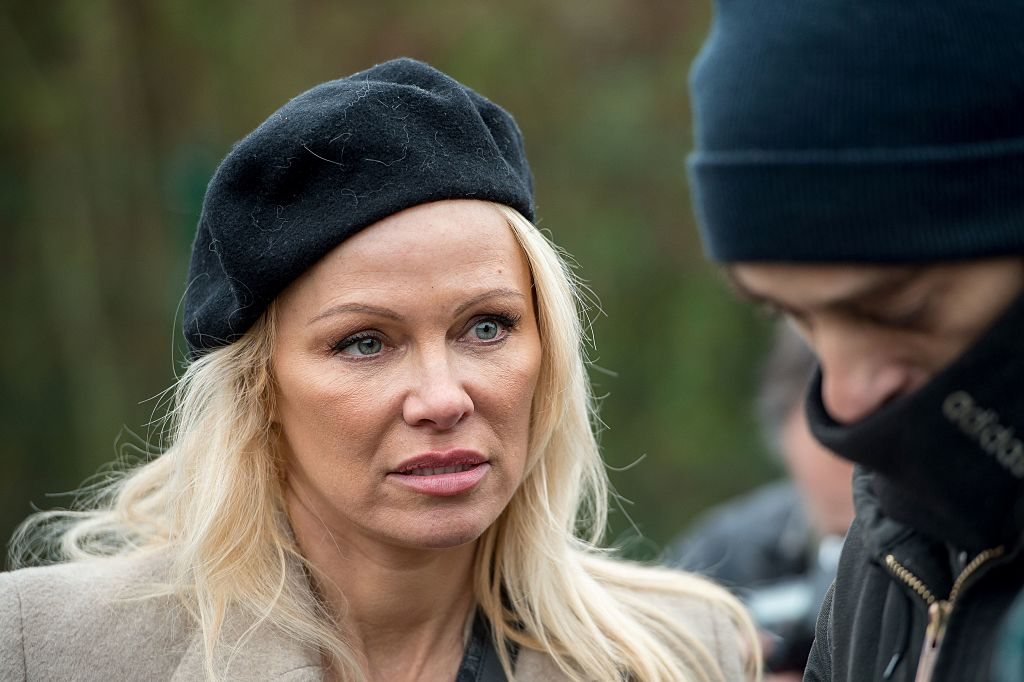 Pamela Anderson speaks with people in the migrant and refugee camp of Grande-Synthe in northern France.