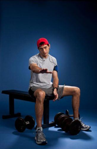 Paul Ryan posing with weights during a photoshoot.