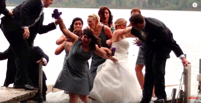 Bridal party falling into water