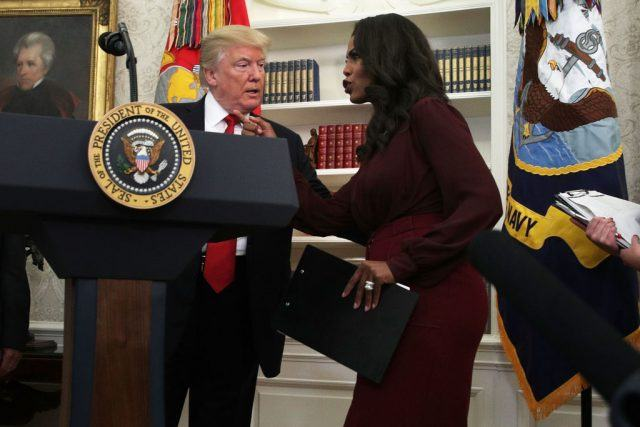 Donald Trump listens to Director of Communications for the White House Public Liaison Office Omarosa Manigault during an event.