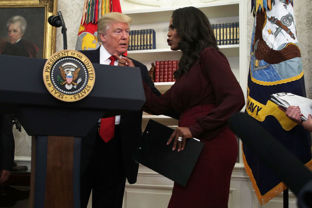 Donald Trump listens to Director of Communications for the White House Public Liaison Office Omarosa Manigault during an event