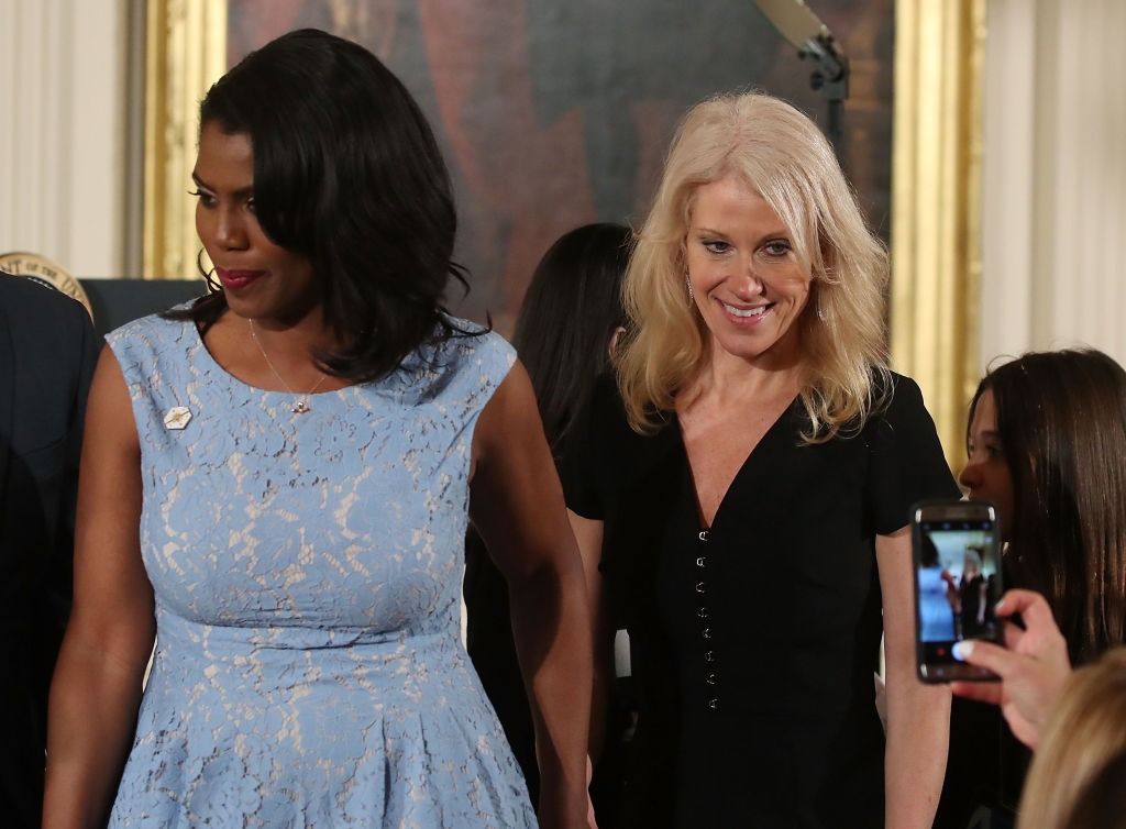 Counselor to the President Kellyanne Conway (R) and Omarosa Manigault (L) attend an event celebrating Women's History Month