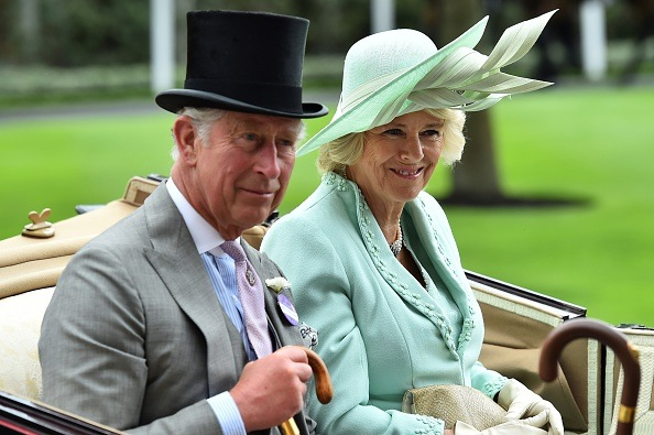 Prince Charles and Camilla in a carriage.