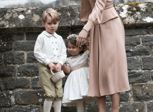 Prince George and Princess Charlotte standing with their mother.
